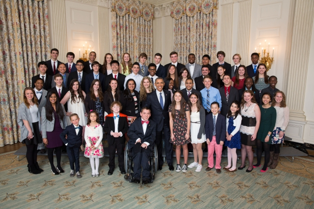 President Barack Obama joins students for a group photo in the State Dining Room during the White House Student Film Festival, March 20, 2015. (Official White House Photo by Lawrence Jackson) This photograph is provided by THE WHITE HOUSE as a courtesy and may be printed by the subject(s) in the photograph for personal use only. The photograph may not be manipulated in any way and may not otherwise be reproduced, disseminated or broadcast, without the written permission of the White House Photo Office. This photograph may not be used in any commercial or political materials, advertisements, emails, products, promotions that in any way suggests approval or endorsement of the President, the First Family, or the White House.